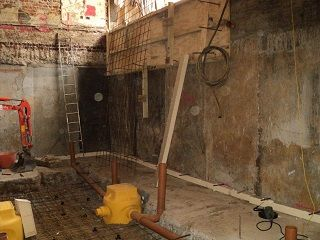 Basement conversion sump pump installation